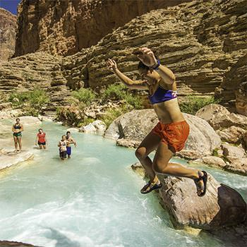 Jumping into Ruby Pools Havasu Creek