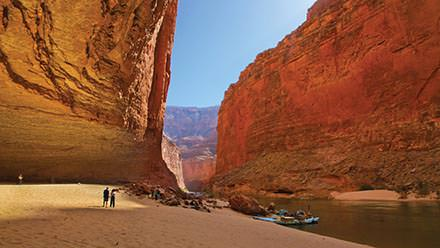 Guests mingle at the edge of Redwall Cavern in Grand Canyon